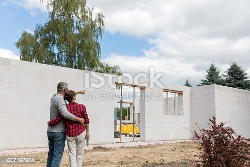 Couple on construction site of new house