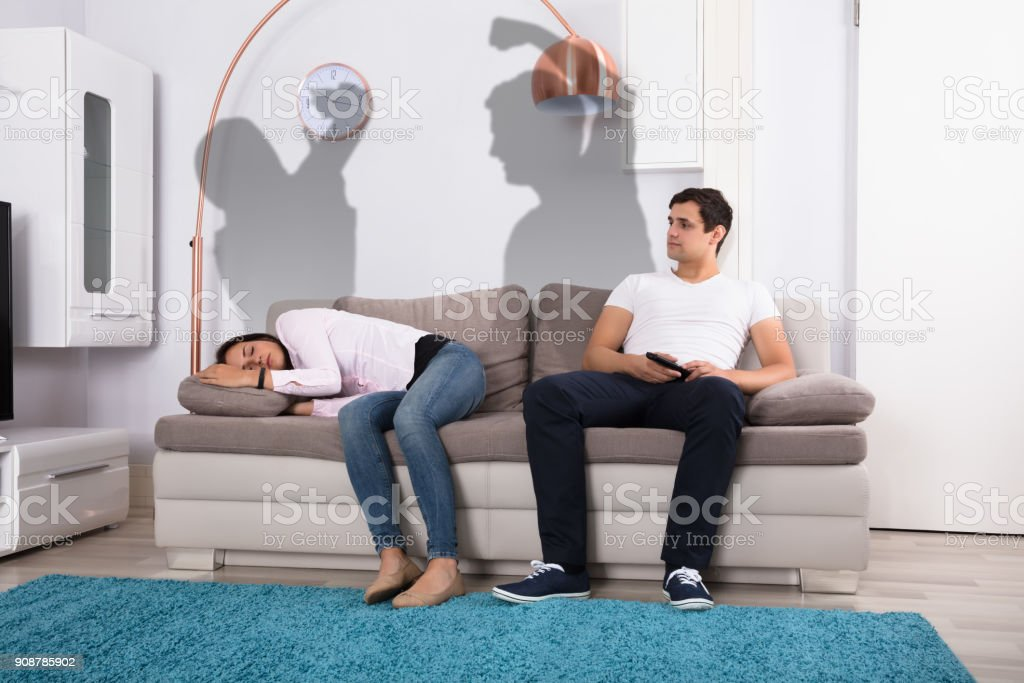 Couple On Couch After Fight stock photo