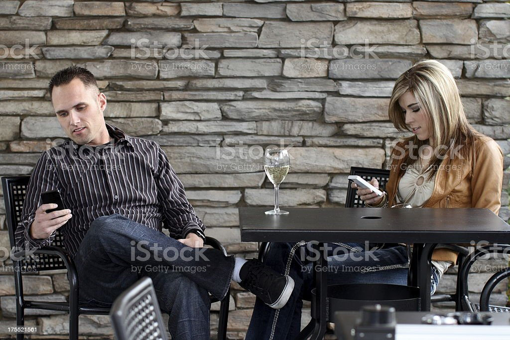 Couple on Date Ignoring Each Other royalty-free stock photo