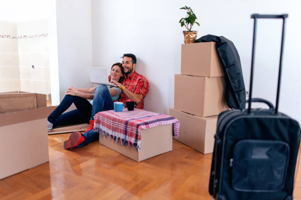 couple on floor next to moving boxes - being in a relationship with someone is going to require stock photos and pictures