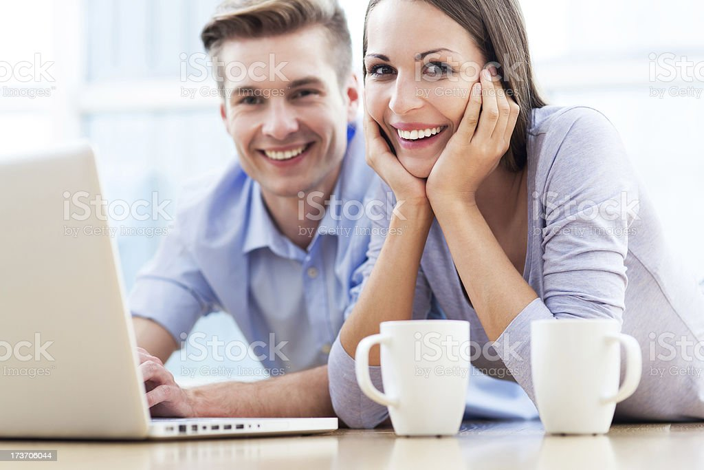 Couple on floor with laptop royalty-free stock photo
