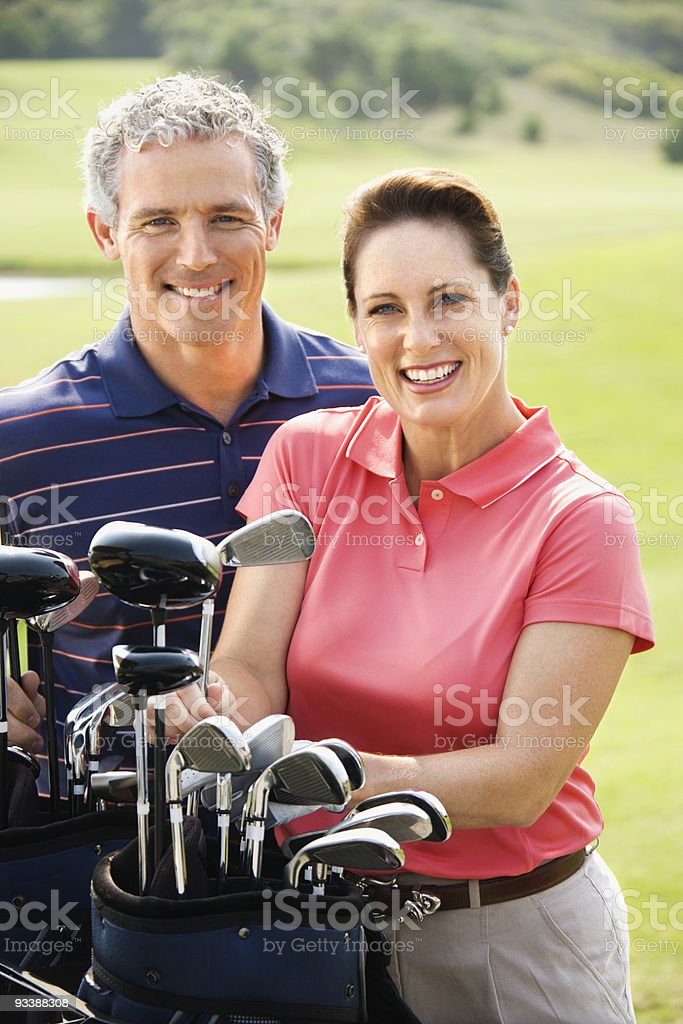 Couple on golf course. royalty-free stock photo