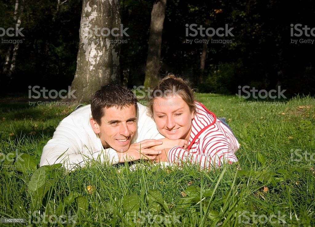 Couple on grass falling in love royalty-free stock photo
