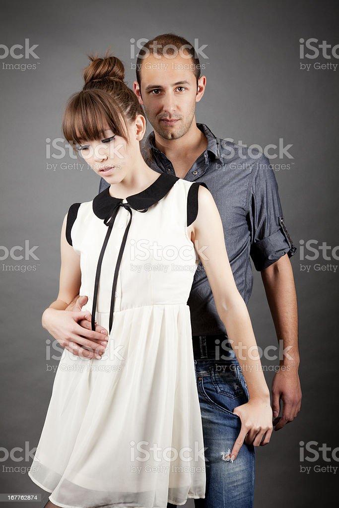 Couple on grey royalty-free stock photo