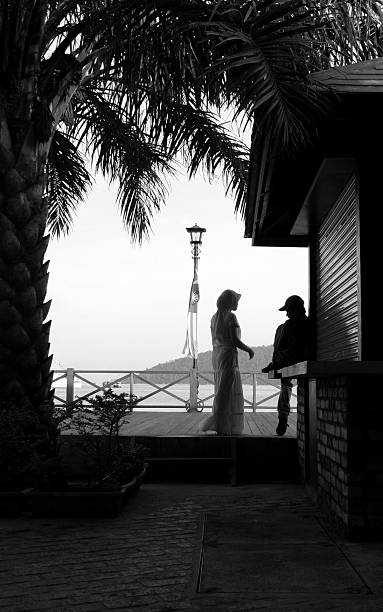 Couple on Kota Kinabalu seafront stock photo