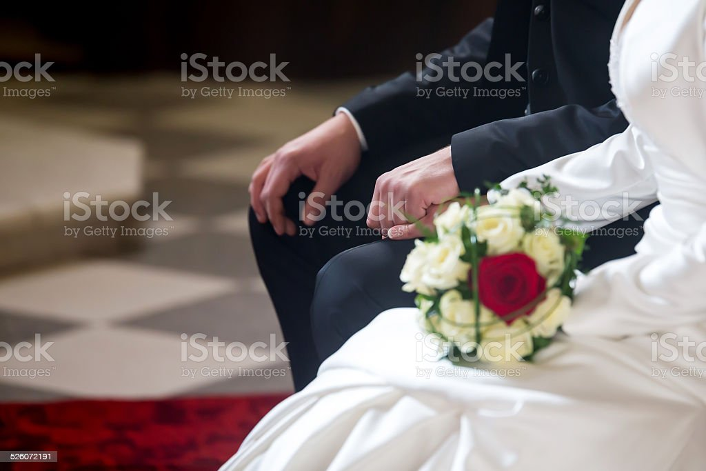 Couple on marriage holding hands stock photo