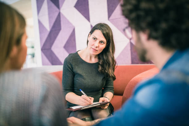 Couple on meeting with counsellor stock photo