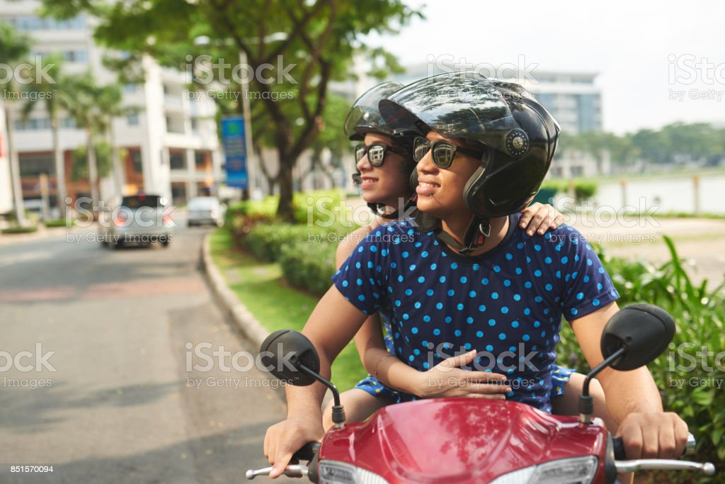 Couple on moped stock photo