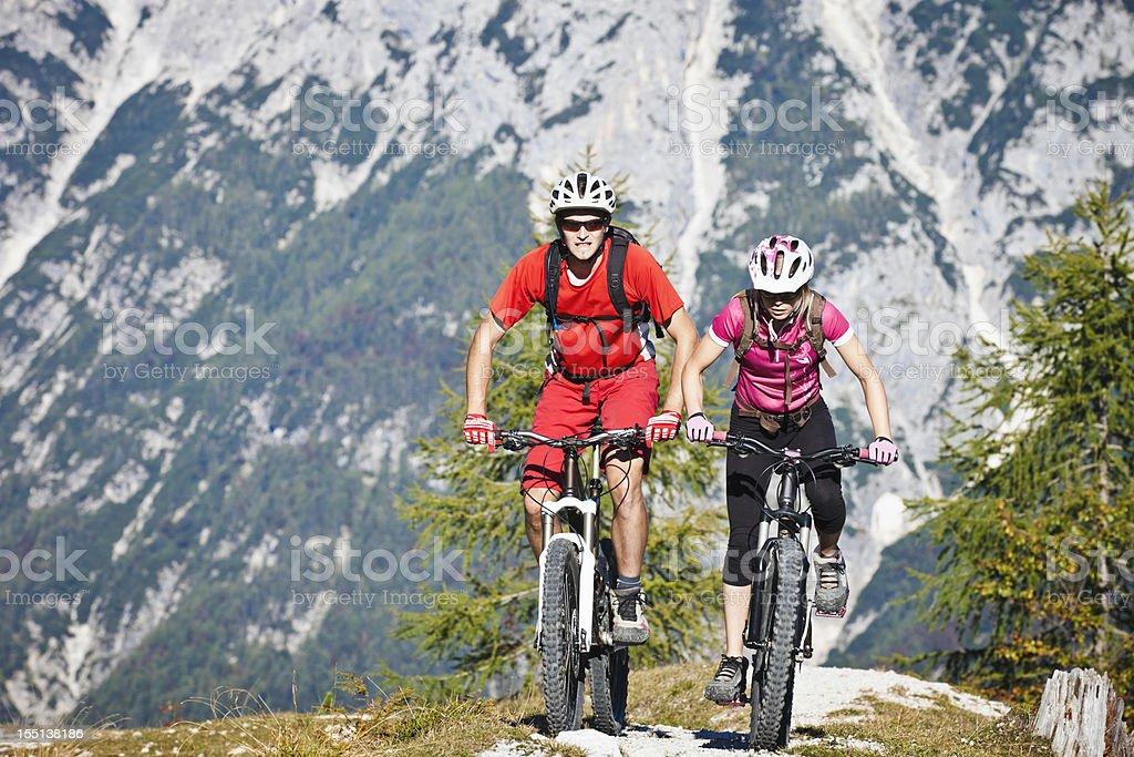 Couple on mountain bikes royalty-free stock photo