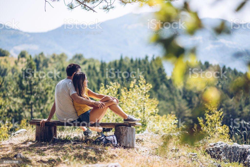 Couple on mountain peak stock photo