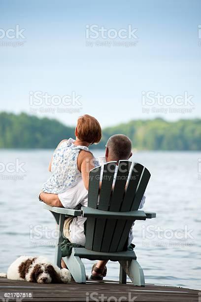Couple on pier morning coffee picture id621707818?b=1&k=6&m=621707818&s=612x612&h=slv 15vjxbcly g90fqvh0xsbltz5g5foeorbkdrvzu=
