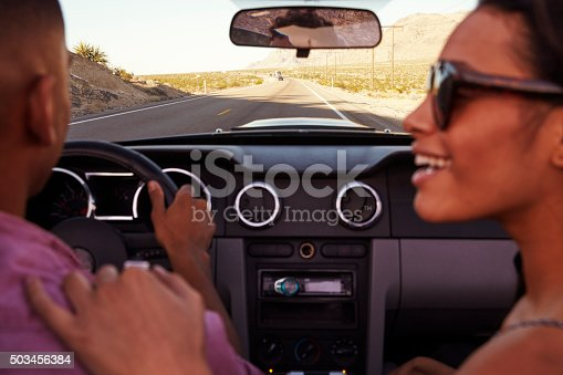 503545320istockphoto Couple On Road Trip Driving In Convertible Car 503456384