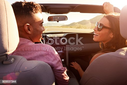 503545320istockphoto Couple On Road Trip Driving In Convertible Car 503537344