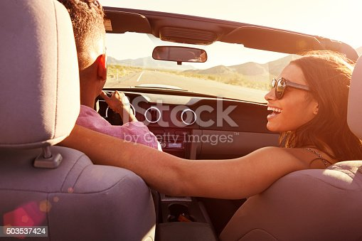 503545320istockphoto Couple On Road Trip Driving In Convertible Car 503537424