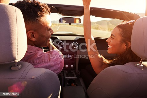 503545320istockphoto Couple On Road Trip Driving In Convertible Car 503537626
