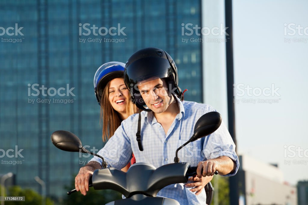 Couple on scooter royalty-free stock photo