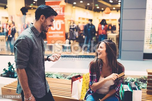 Couple shopping with credit card in the mall