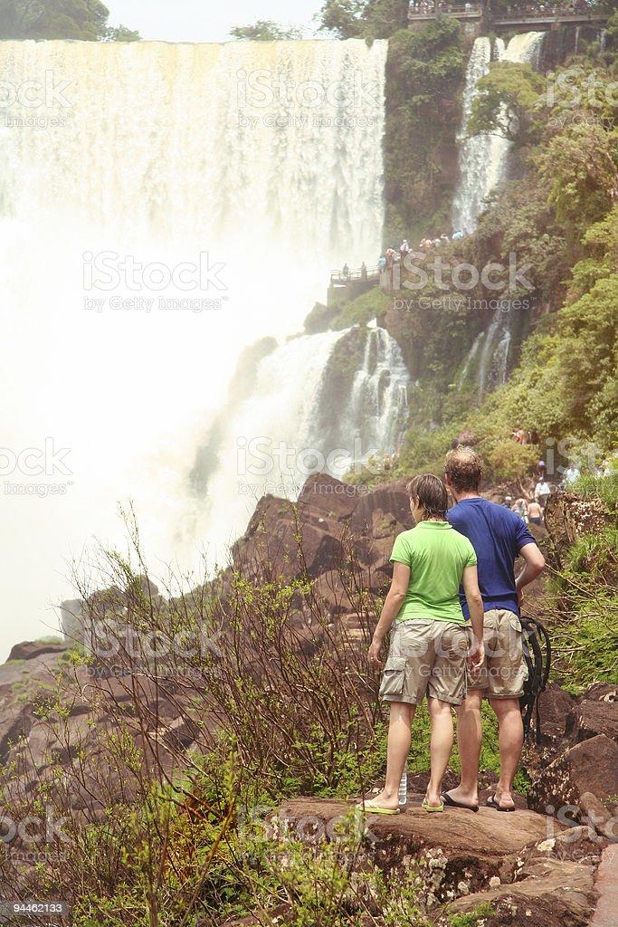 Couple on sightseeing tour Iguazu Falls Argentina royalty-free stock photo