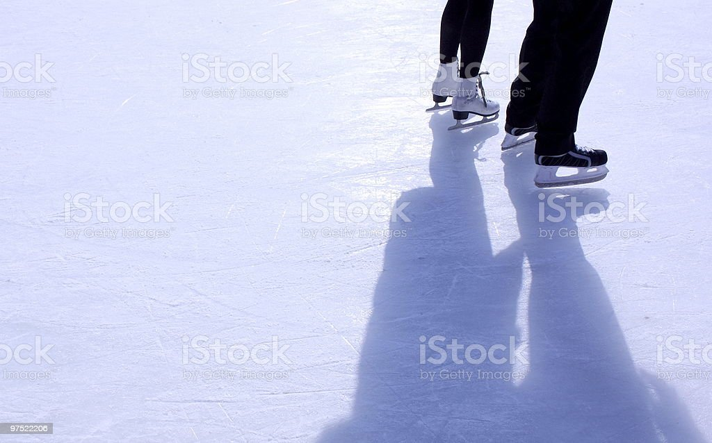 Couple on skating rink stock photo