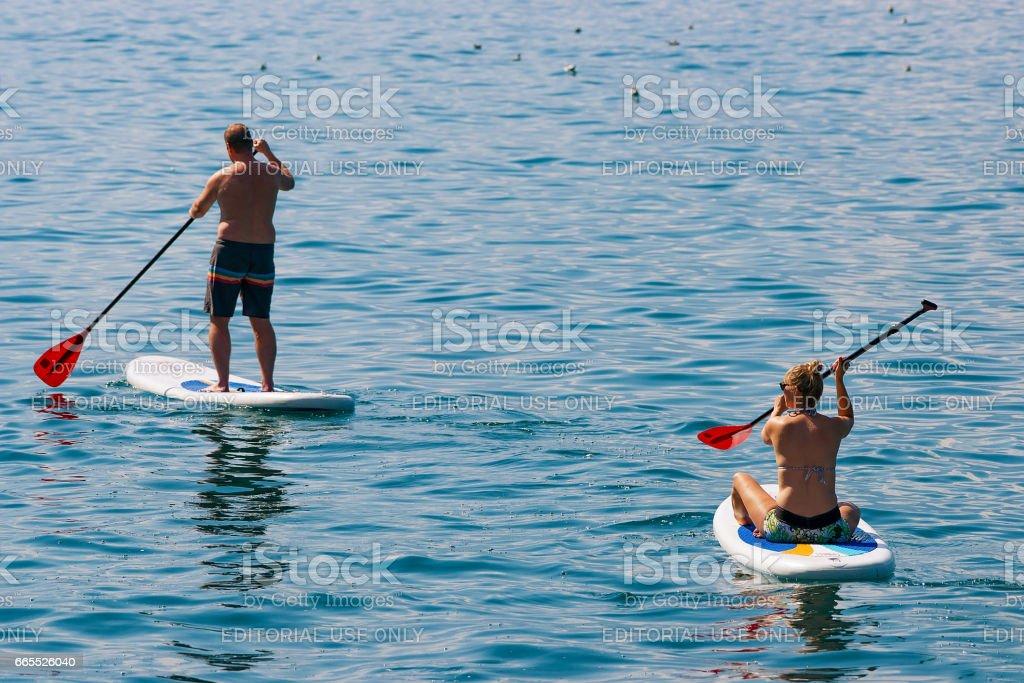 Couple on Standup paddle board on Geneva Lake Montreux stock photo