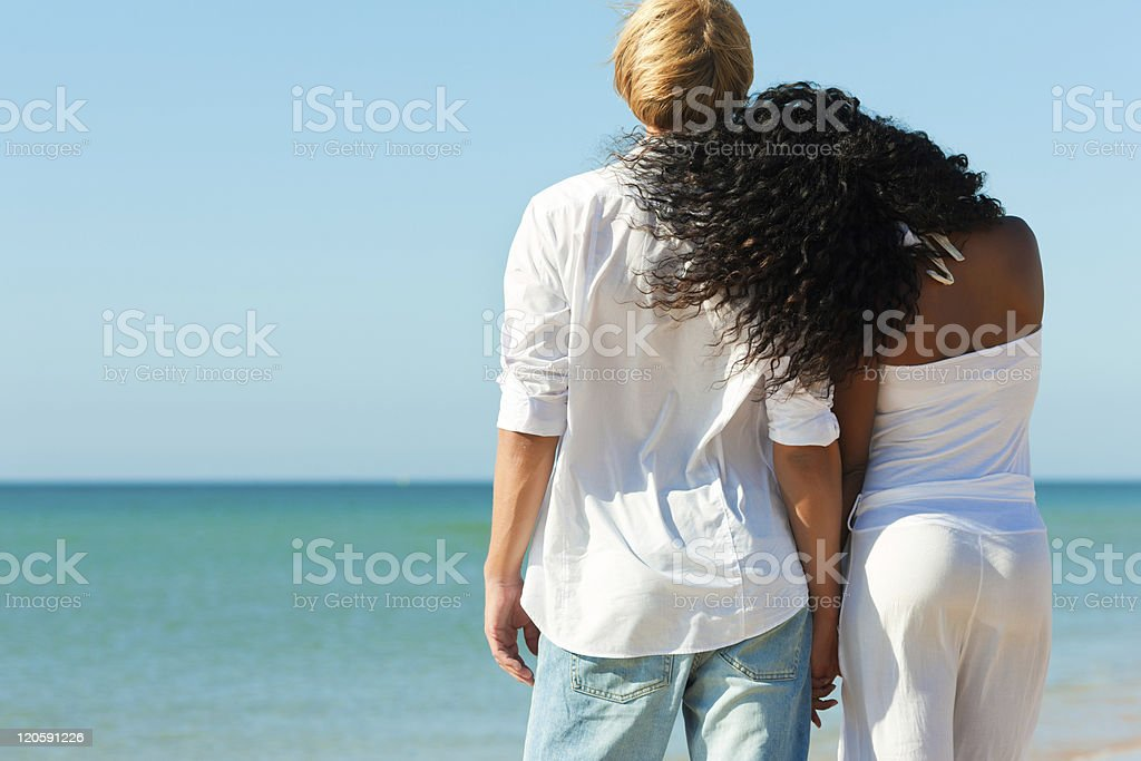 Couple on sunny beach in summer royalty-free stock photo