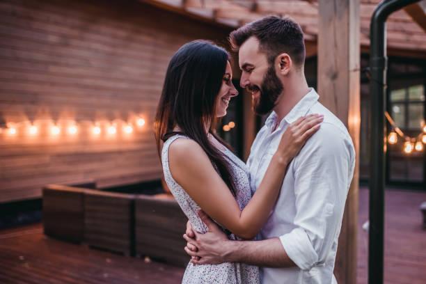 Couple on terrace stock photo