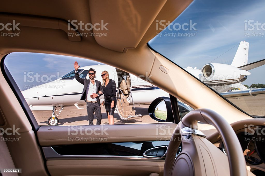 Couple on the airport viewed from the car stock photo