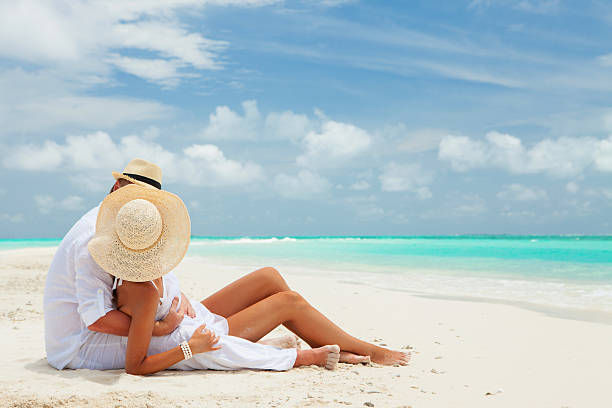 Couple on the beach of sea Couple on the beach of sea honeymoon stock pictures, royalty-free photos & images