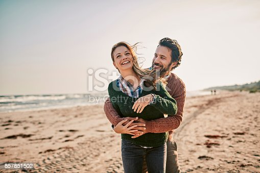 istock Couple on the beach 857851502