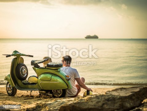 Romantic couple with retro bike on vacation