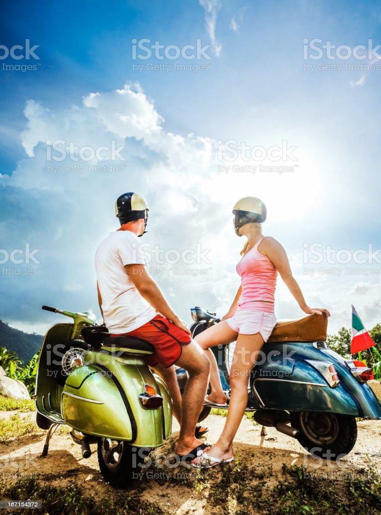 Couple on the mountain with retro bikes royalty-free stock photo