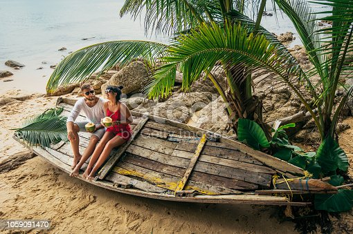 Boy and girl on the shore of Paradise island