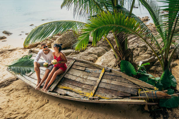 Couple on the shore of Paradise island Boy and girl on the shore of Paradise island romance stock pictures, royalty-free photos & images