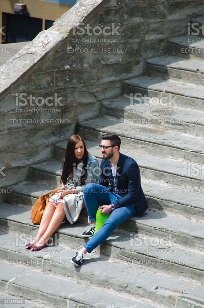 Couple on the Steps of Palazzo Comunale stock photo