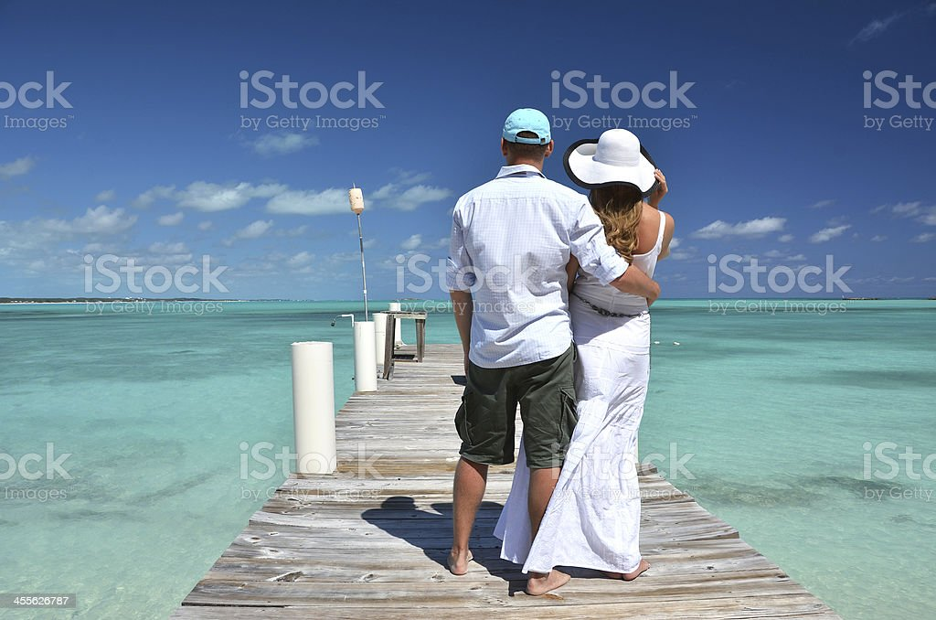Couple on the wooden jetty stock photo