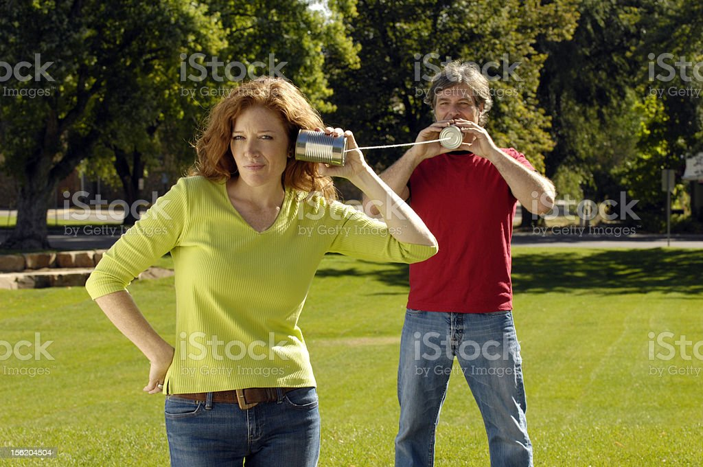 Couple on Tin-Can Telephone royalty-free stock photo
