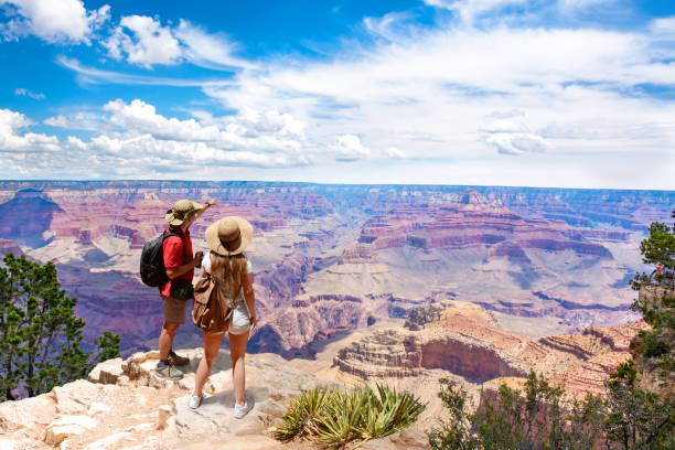 Couple on top of the mountain, looking at beautiful summer mountain  landscape. stock photo