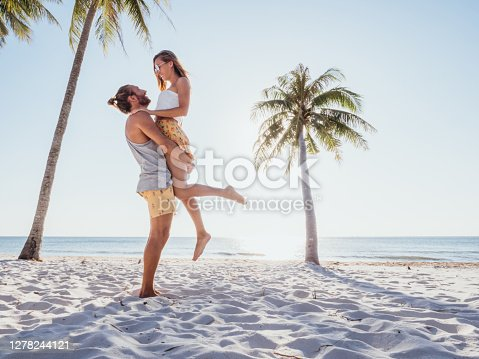 Young couple relaxing on beach in Vietnam