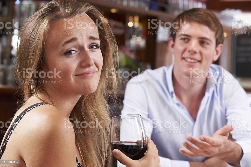 Couple On Unsuccessful Blind Date In Restaurant stock photo