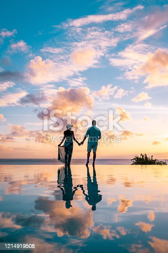 couple on vacation at the tropical Island of St Lucia, men and woman watching sunset Saint Lucia Caribbean ocean