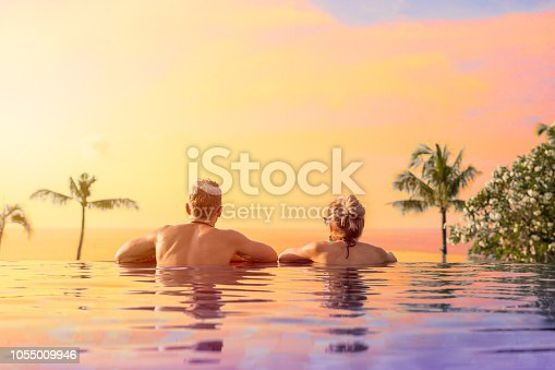 1055009962 istock photo Couple on vacation in tropical resort 1055009946