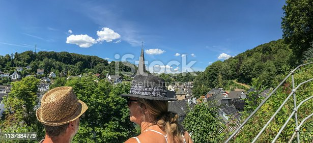 Vacation trip in Germany with a view over a historical village