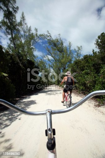istock Couple on Vacation riding bikes 175499250