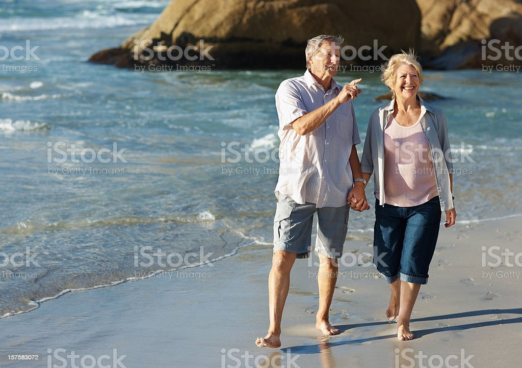 Couple on vacation , taking a walk at the beach royalty-free stock photo