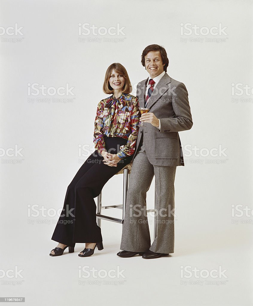 Couple on white background, man holding drink stock photo