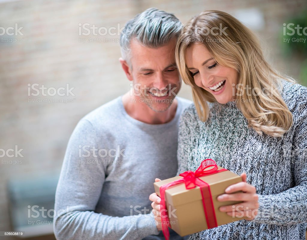 Couple opening a gift stock photo