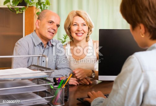 584597964 istock photo Couple opening account in bank 510900777