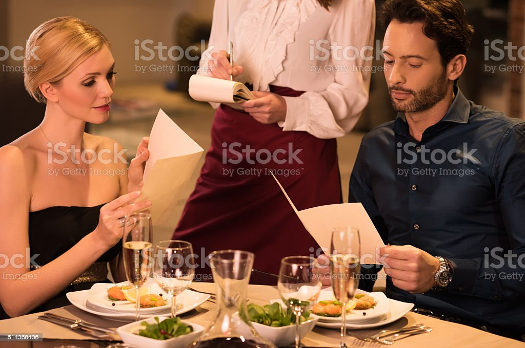 Couple ordering food stock photo