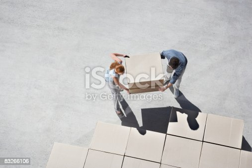istock Couple organizing boxes 83266106