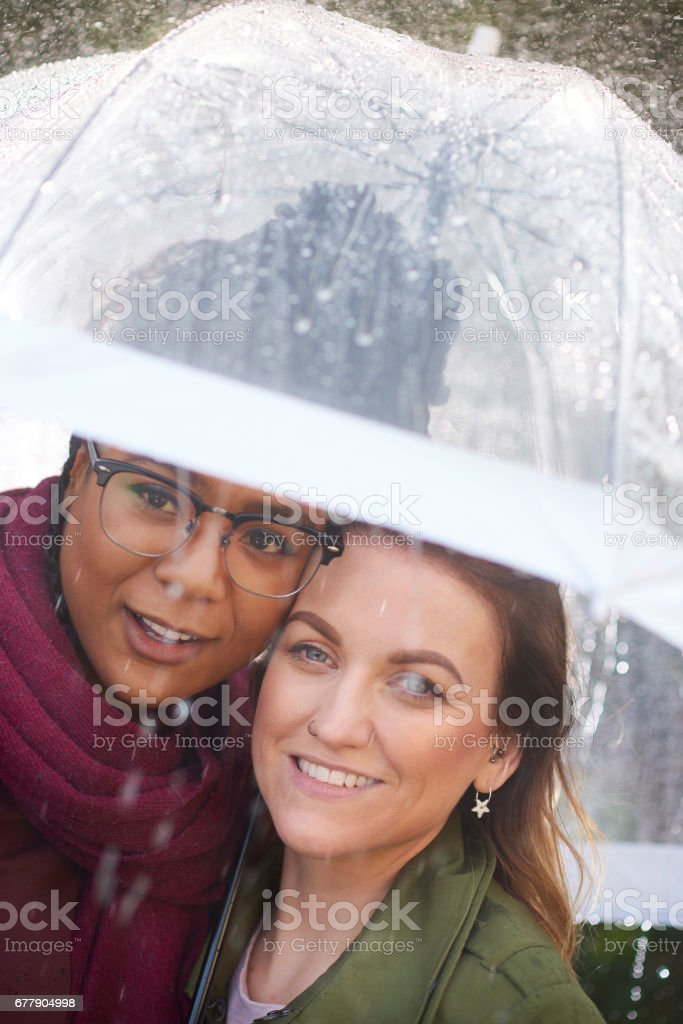 couple out on walk caught in the rain royalty-free stock photo